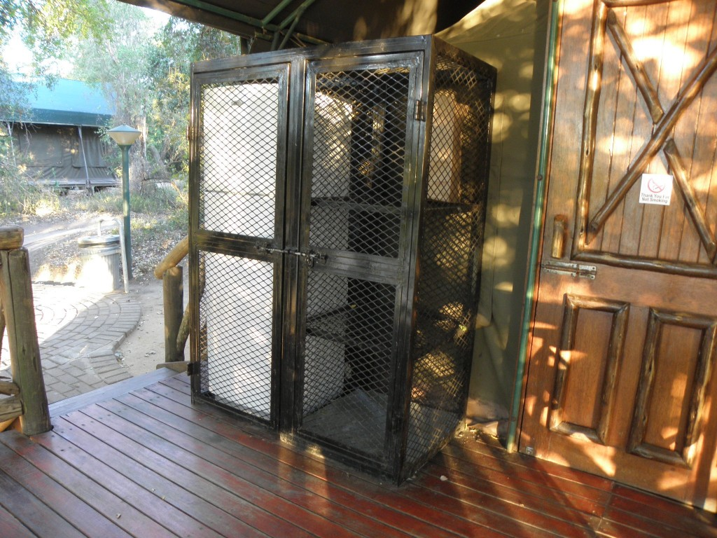 The fridge and food cupboard are closed in sturdy ire mesh to protect against monkeys, baboons and honey badgers